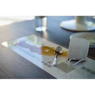 Clavier plat capacitif avec une surface en verre