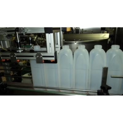 Oriënteren van vierkante flessen